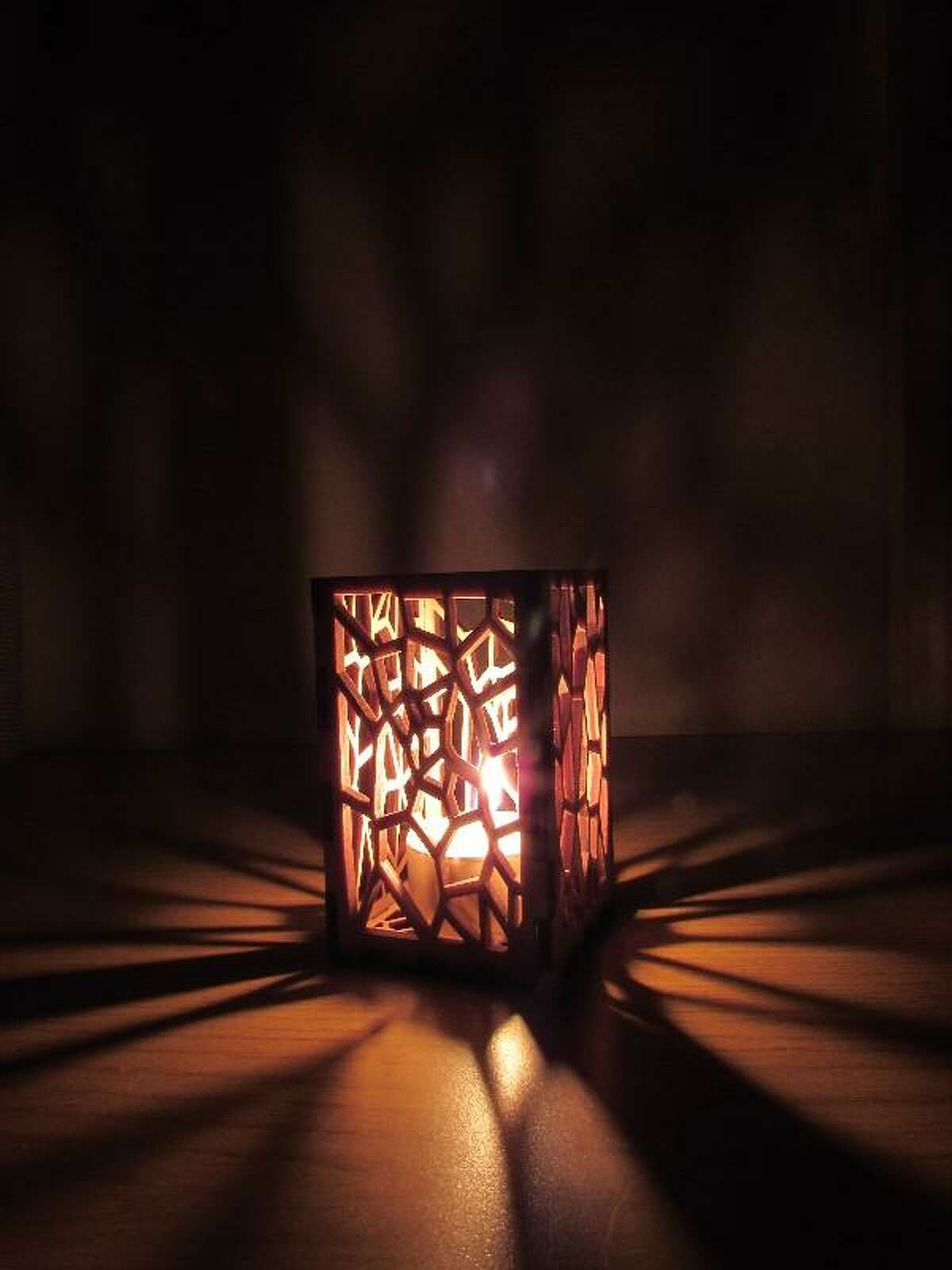 Create a cozy atmosphere in your tent by placing a battery-powered tea light in this candle holder.