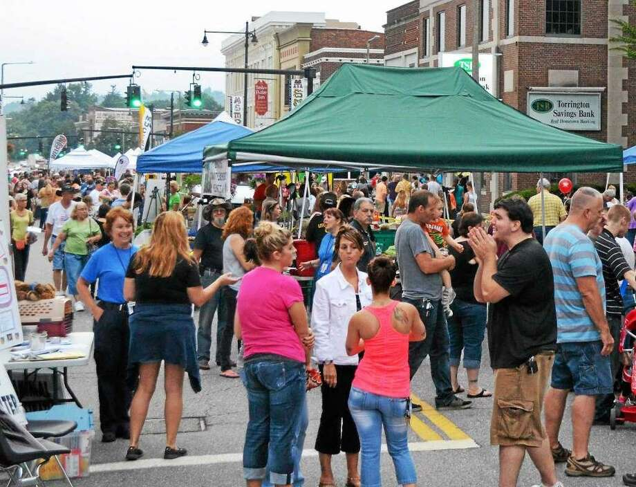 Torrington's Main Street Marketplace will be held on Wednesdays, July 11, 18, 25 and Aug. 1. The street fair has attracted several thousand people to Main Street for shopping, food and live entertainment for children and adults. Click through to see more photos from last year's event. Photo: File Photo
