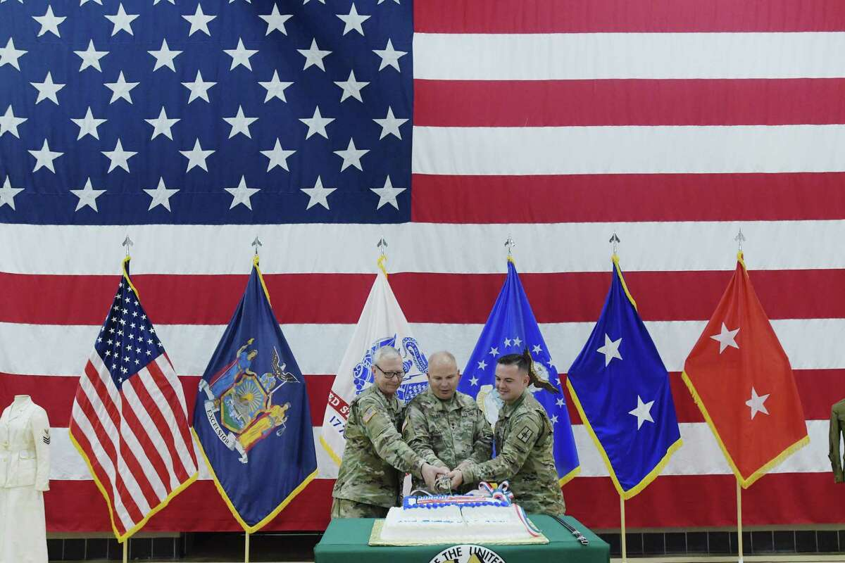 Master Sgt. John Batza, left, Major General Raymond Shields, center, and Sgt. Tyler Center, take part in a ceremonial cutting of the cake at an event at the New York State Division of Military and Naval Affairs Headquarters to celebrate the 243rd birthday of the United States Army on Thursday, June 14, 2018, in Latham, N.Y. (Paul Buckowski/Times Union)