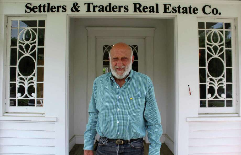 Westport resident Michael Calise outside his real estate firm, Settlers & Traders, on Post Road West in Westport. Photo: Sophie Vaughan / Hearst Connecticut Media / Westport News