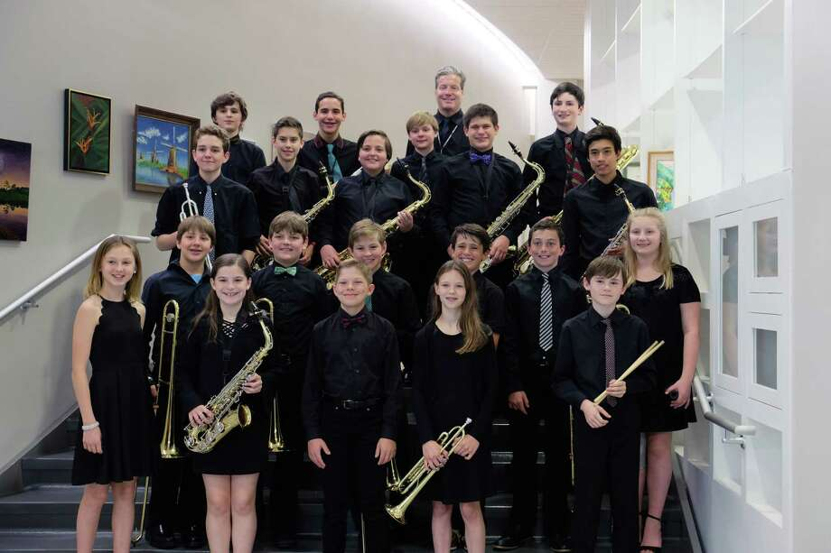 The Middlesex Middle School Jazz Band played for the Darien Senior Center on May 31. Bottom row, from left: Paige Domenici, Katie Keating, Ryan Hoffman, Amelia Del Bene and Cillian Hallinan. Second row, from left: Will Hopper, Bohdan Czebiniak, Nick Huffman, Teddy Peters, Dylan DeRiso and Charlotte Krueger. Third row, from left: Luke Riordan, Oliver West, Will Abbott, Austin Ennor and Khrystos Yika. Fourth row, from left: Cosmo Amatruda, Jake Dansker, Jack McDermott, Jim Carter (director) and Drew Passaretti. Photo: /