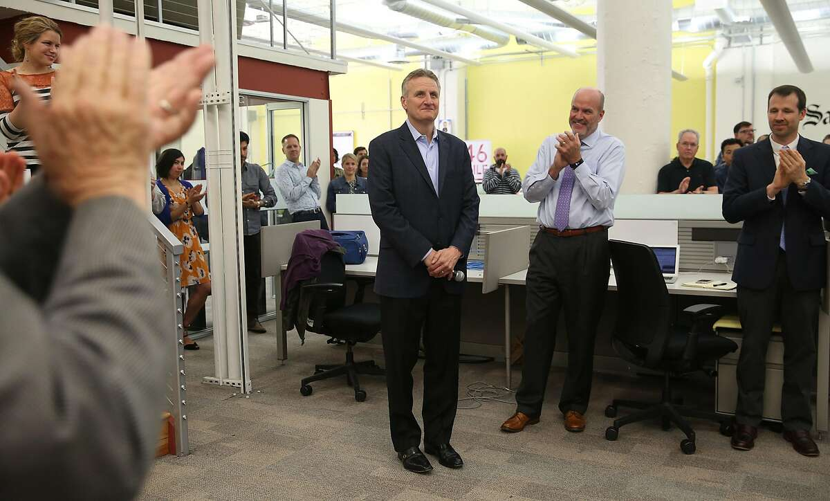 Jeffrey M.Johnson (middle) leaves publishing as Bill Nagel (middle right) becomes the new Chronicle publisher at the San Francisco Chronicle on Thursday, June 14, 2018 in San Francisco, Calif.