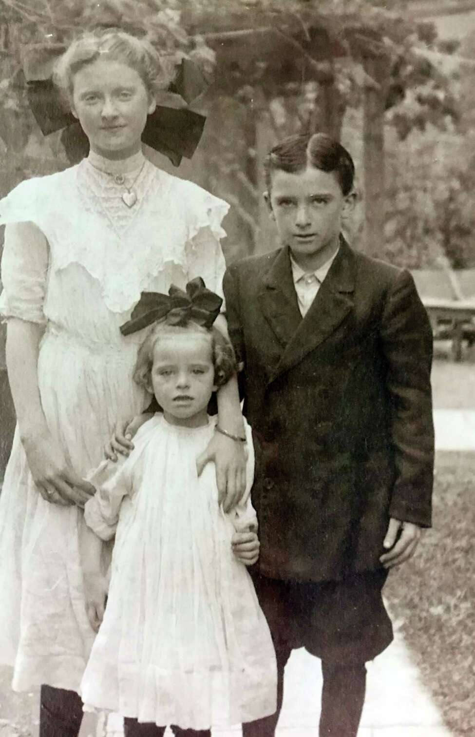 WWI hero and Troy High School alum Jack Callahan joins his sisters for a family photo. The smaller girl on his left is the grandmother of Lisa Karam, who has appealed to U.S. Secretary of Defense Jim Mattis to honor Callahan's valor posthumously. Callahan was killed at age 18 in a battle to defend Paris. He continued advancing into enemy machine gun fire after being mortally wounded. (Provided by family)