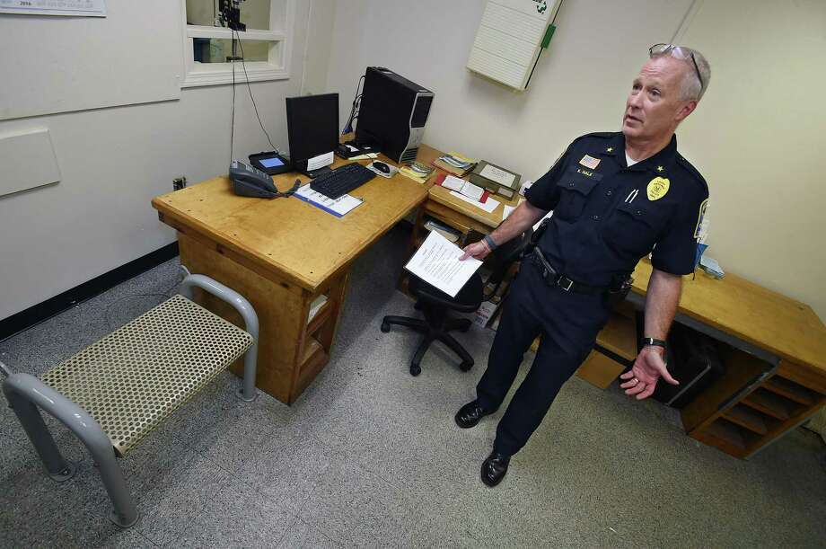 Ansonia Police Chief Kevin Hale in the booking room at police headquarters, Wednesday, October 19, 2016, during a public tour of the antiquated facility, built in 1894 as the former Larkin School. Photo: Catherine Avalone / New Haven Register / New Haven RegisterThe Middletown Press