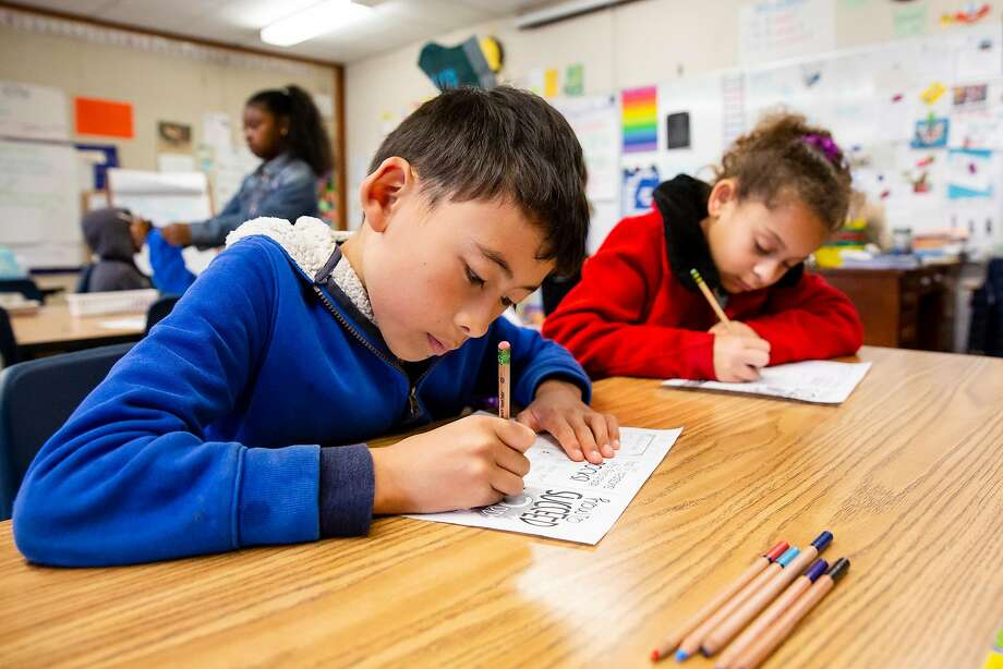 August Chen Penningroth (left) and Olivia Spencer write with compostable unpainted vegetable ink and cedar wood pencils in Jackie Omania's 3rd-grade classroom at Oxford Elementary School in Berkeley. Photo: Photos By Brittany Hosea-Small / Special To The Chronicle