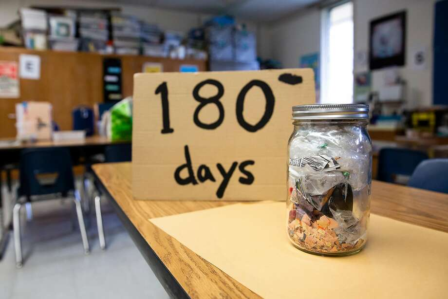 Above: A Mason jar filled with 180 days worth of trash from Jackie Omania's 3rd grade classroom sits on a desk at Oxford Elementary School in Berkeley, Calif. on Thursday, June 14, 2018. Jackie Omania and her students have turned their classroom into a zero-waste classroom, reducing their entire school year's supply of trash to one Mason jar. Top: August Chen Penningroth (left) and Olivia Spencer write with compostable unpainted vegetable ink and cedar wood pencils in Jackie Omania's 3rd grade classroom at Oxford Elementary School in Berkeley, Calif. on Thursday, June 14, 2018. Jackie Omania and her students have turned their classroom into a zero-waste classroom, reducing their entire school year's supply of trash to one Mason jar. Photo: Brittany Hosea-Small / Special To The Chronicle