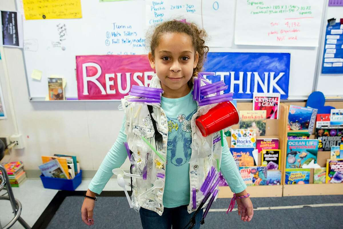 Olivia Spencer poses for a photo in a plastic pollution awareness jacketin Jackie Omania's 3rd grade classroom at Oxford Elementary School in Berkeley, Calif. on Thursday, June 14, 2018. The jacket was created the year before by Annie Rothschild.