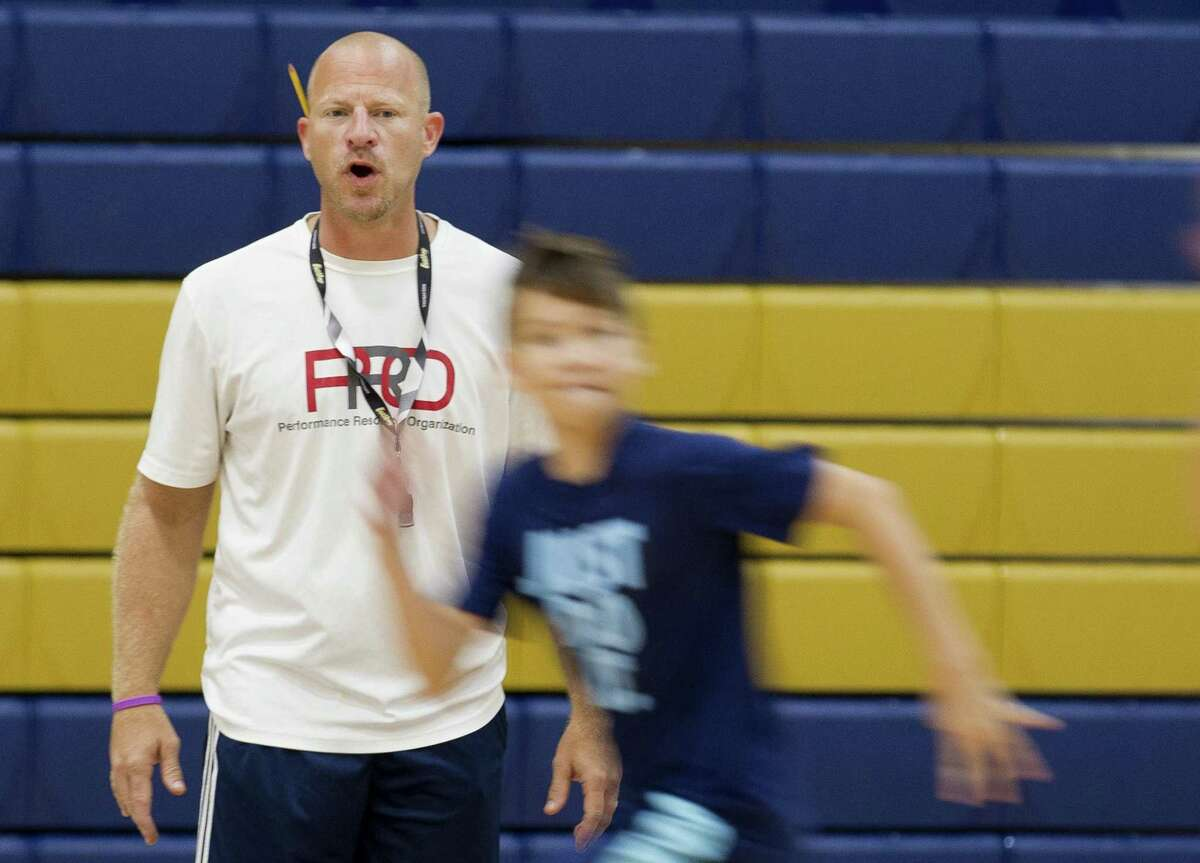 Lake Creek head coach Shannon Spencer watches campers run a drill during a basketball camp at Oak Hills Junior High School on Wednesday in Montgomery.