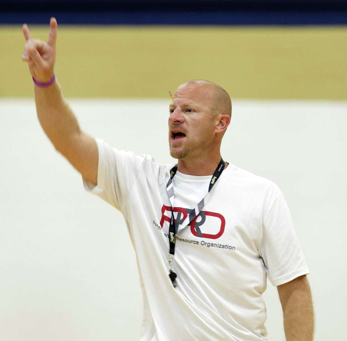 Lake Creek head coach Shannon Spencer shouts instructions during a basketball camp at Oak Hills Junior High School on Wednesday in Montgomery.