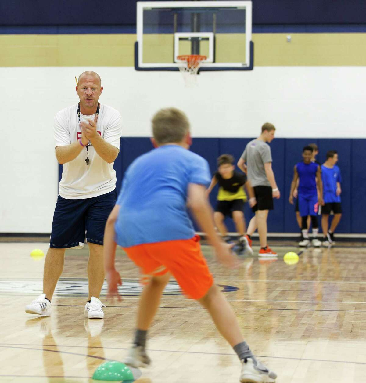 Lake Creek head coach Shannon Spencer encourages campers during a basketball camp at Oak Hills Junior High School on Wednesday, June 13, 2018, in Montgomery.