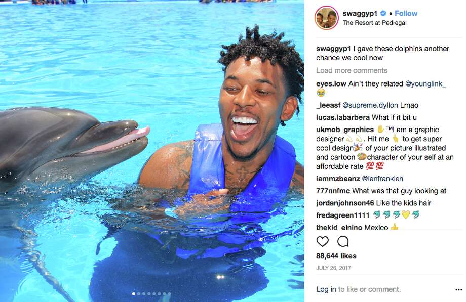 """Favorite vacation spots of the Golden State Warriors Nick Young loves family trips to Mexico, including this fun 2017 excursion to Cabo San Lucas. The dolphin meet-and-greet allowed Swaggy P to make peace with the ocean creature. While with the Lakers, Young said a """"dolphin tried to kill"""" him. """"It was my turn to ride the dolphin, and for some reason he took me all the way to the bottom so um, he was trying to drown me,"""" Young said. He is now """"cool"""" with dolphins. Photo: Screenshot Via Twitter"""