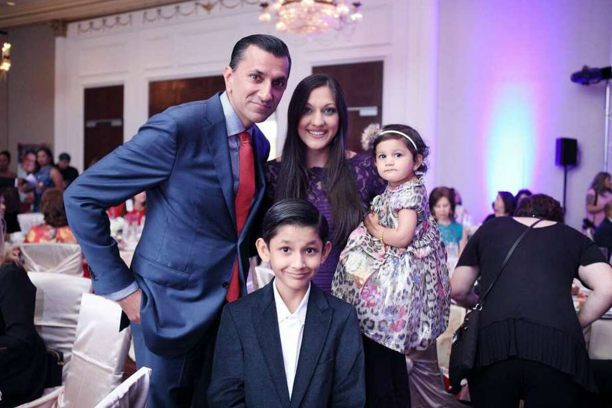 AJAY KHURANA Profession: Co-head of Energy for the Americas Children: Shaan, 8, and Seva, 2. (Also in photo, wife, Sippi)