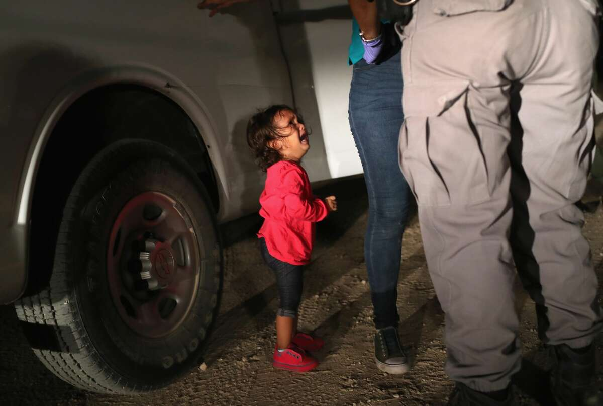 A two-year-old Honduran asylum seeker cries as her mother is searched and detained near the U.S.-Mexico border on June 12, 2018 in McAllen, Texas. The asylum seekers had rafted across the Rio Grande from Mexico and were detained by U.S. Border Patrol agents before being sent to a processing center for possible separation. See photos of U.S. Border Patrol working along the U.S.-Mexico border earlier this year ...