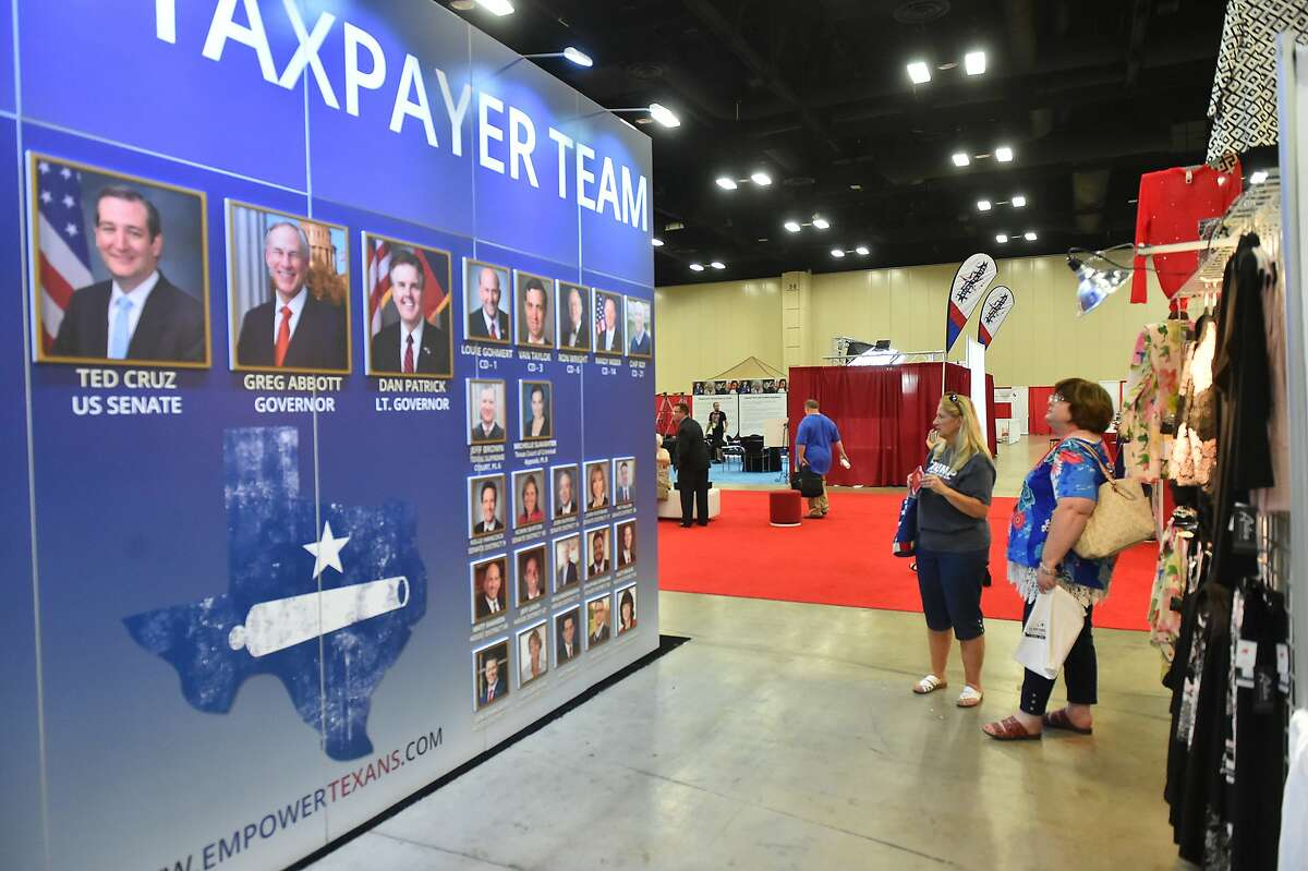 Janis Holt, Silsbee, and Sheila Faske, Rose City, look over a display at the Henry B. Gonzalez Convention Center as the Texas Republican Convention gets underway.