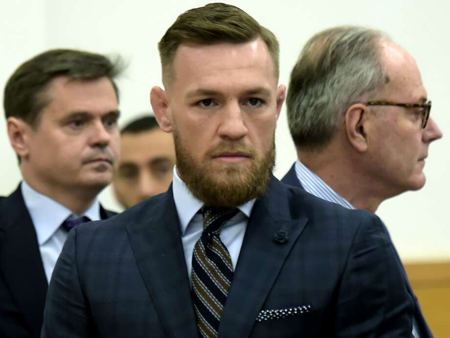 Mixed martial arts fighter Conor McGregor, center, arrives at Brooklyn Supreme Court, Thursday, June 14, 2018, in New York. McGregor expressed regret on Thursday for a backstage melee at a Brooklyn arena, and is in plea negotiations to resolve charges in the case. (Rashid Umar Abbasi /New York Post via AP, Pool) Photo: Rashid Umar Abbasi / Associated Press