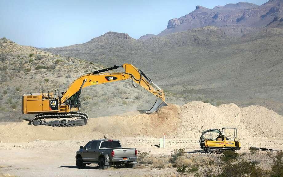 Earth moving equipment spreads dirt over the Trans-Pecos Pipeline near Presidio, TX. Photo: Bob Owen/San Antonio Express-News