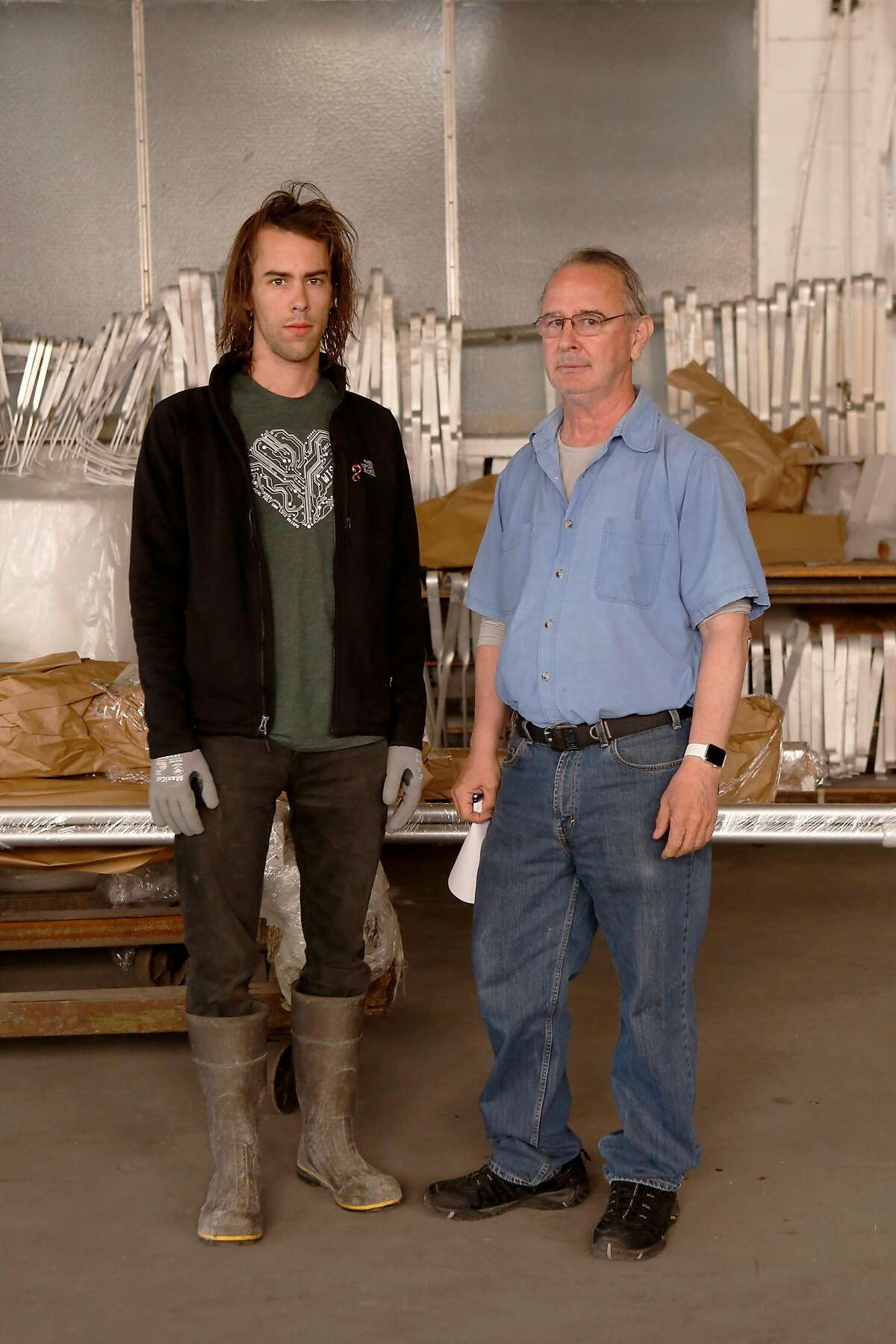 Bill Beard, left, the CEO of Metalco since 2013, works with son Jesse Beard in their shop on Thursday, June 14, 2018 in Emeryville, Calif. Metalco is a small, 70-year-old family-run business which is allegedly being evicted by Berkeley Bowl.