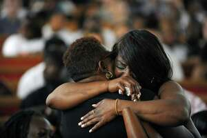 Michelle Warren, right, the mother of 18-year-old Antonio Robinson, who was slain on May 31, gets a hug during her son's funeral Thursday at Faith Tabernacle Missionary Baptist Church in Stamford.