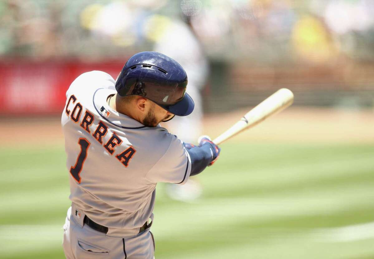 OAKLAND, CA - JUNE 14: Carlos Correa #1 of the Houston Astros hits a single that scored a run in the third inning against the Oakland Athletics at Oakland Alameda Coliseum on June 14, 2018 in Oakland, California.