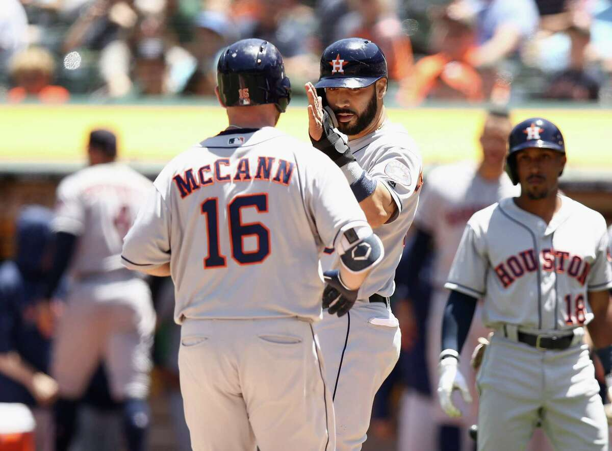 OAKLAND, CA - JUNE 14: Marwin Gonzalez #9 of the Houston Astros congratulates Brian McCann #16 after he hit a home run in the fourth inning against the Oakland Athletics at Oakland Alameda Coliseum on June 14, 2018 in Oakland, California.