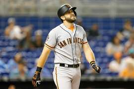 MIAMI, FL - JUNE 14:  Evan Longoria #10 of the San Francisco Giants reacts after being hit by a pitch in the third inning against the Miami Marlins at Marlins Park on June 14, 2018 in Miami, Florida.  (Photo by Michael Reaves/Getty Images)