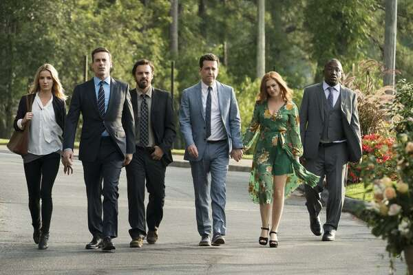 """Annabelle Wallis (left), Jon Hamm, Jake Johnson, Ed Helms, Isla Fischer and Hannibal Buress in """"Tag,"""" which has five grown men in an annual game that's been going on for decades."""