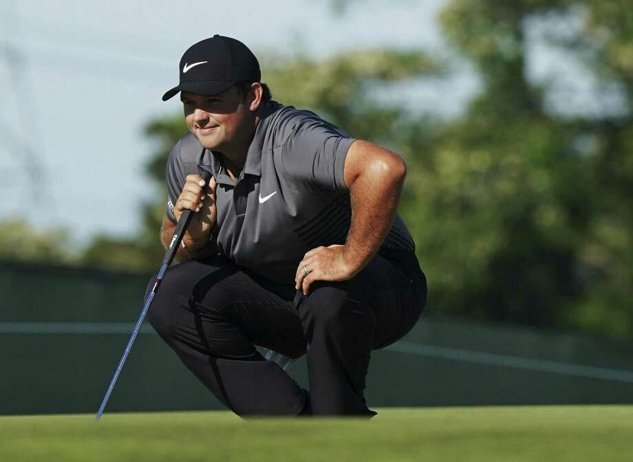 Patrick Reed lines up a shot on the 10th green during the first round of the U.S. Open Thursday in Southampton, N.Y. Photo: Carolyn Kaster / Associated Press / Copyright 2018 The Associated Press. All rights reserved.