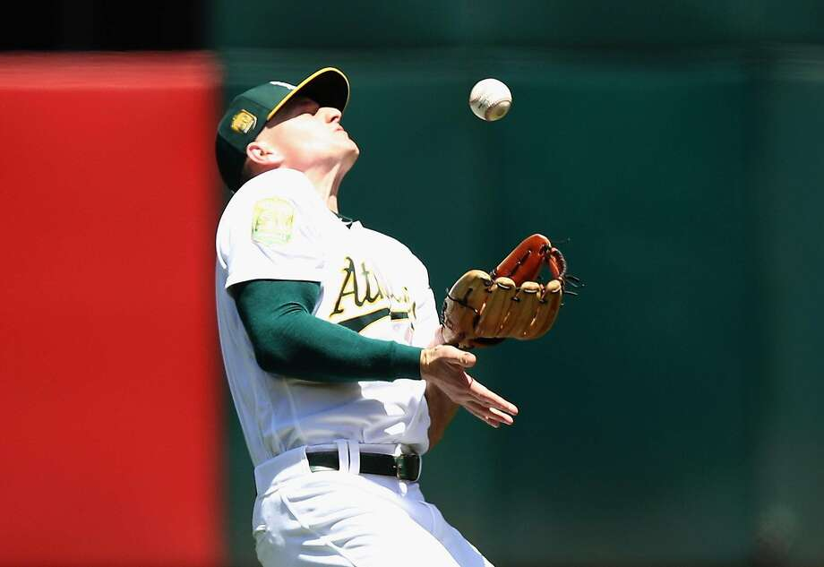 OAKLAND, CA - JUNE 14:  Matt Chapman #26 of the Oakland Athletics misplays a ball hit by Brian McCann #16 of the Houston Astros in the sixth inning at Oakland Alameda Coliseum on June 14, 2018 in Oakland, California.  (Photo by Ezra Shaw/Getty Images) Photo: Ezra Shaw / Getty Images