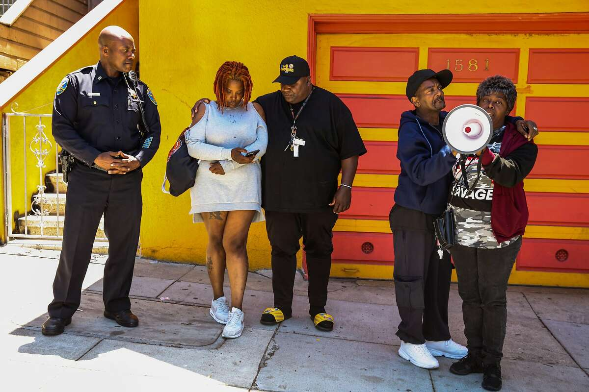 Sarah Inez Thomas- Cael (second from left), Lorenzo Cael Sr. (second from right). and Wanda Fain (right), the wife and parents of Jevon Cael who was killed last Monday in the Bayview speak during a prayer service in the Bayview in San Francisco, California, on Monday, June 11, 2018. Bayview Station Capt. Steven Ford (left) lead the event.