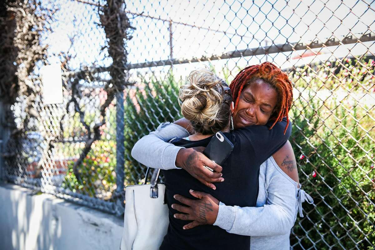 Sara Inez Thomas-Cael (right), is comforted after a service for her husband Jevon Cael who was killed last Monday in the Bayview in San Francisco, California, on Monday, June 11, 2018.