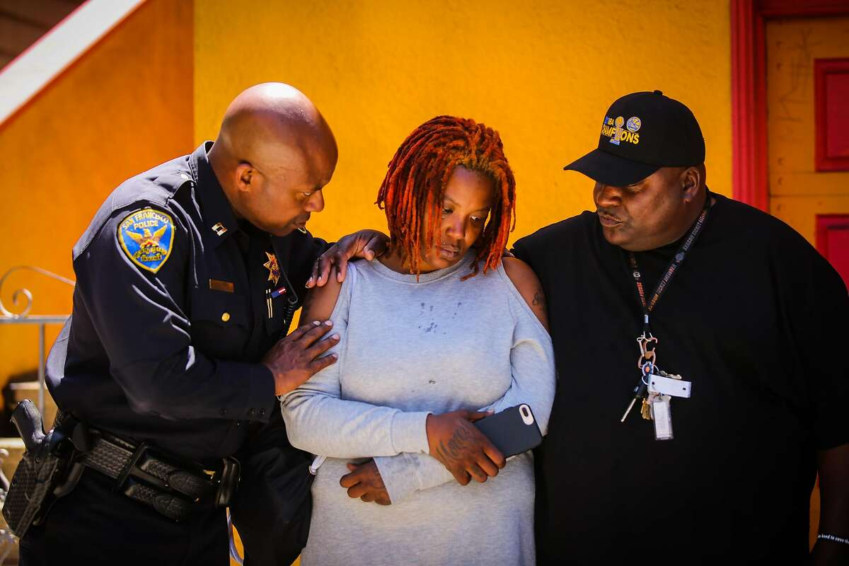 Bayview Station Capt. Steven Ford (left) comforts Sarah Inez Thomas-Cael, the wife of Jevon Cael who was killed last Monday in the Bayview during a prayer service in the Bayview in San Francisco, California, on Monday, June 11, 2018.
