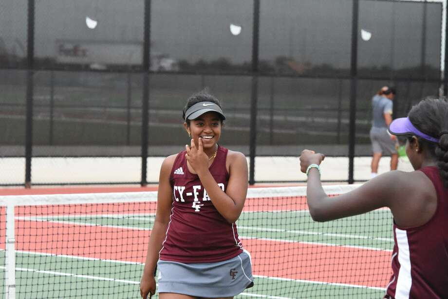 Cy Fair freshman Kayal Gownder (center) and girls doubles partner sophomore Shalom Victor won their bracket at the District 17-6A Tennis Tournament, April 3-5 at Bridgeland High School, to advance to regionals. Photo: CFISD