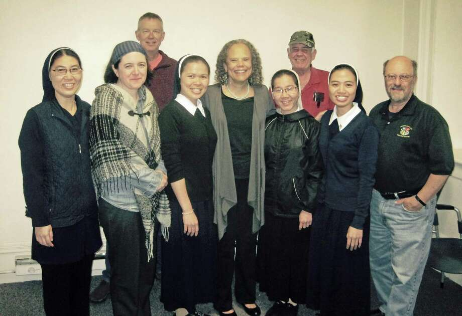 The veterans writing group at Middletown's Russell Library was treated this week to a visit from Vietnamese sisters from the Holy Apostles College & Seminary in Cromwell. The women, who have been in Cromwell for eight months and are learning the English language, sang native songs for members. Photo: Contributed Photo