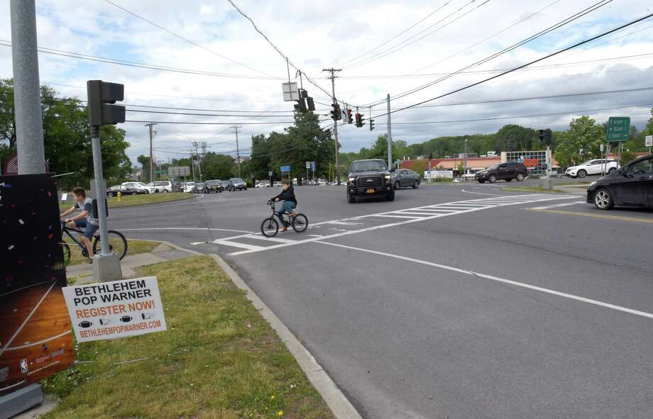 Kids cross the road on their bikes at the intersection at Rt. 9W and Feura Bush Rd. on Thursday, June 14, 2018 in Glenmont, N.Y. Bethlehem is holding meeting on a proposed roundabout at the busy intersection. (Lori Van Buren/Times Union) Photo: Lori Van Buren, Albany Times Union / 20044119A