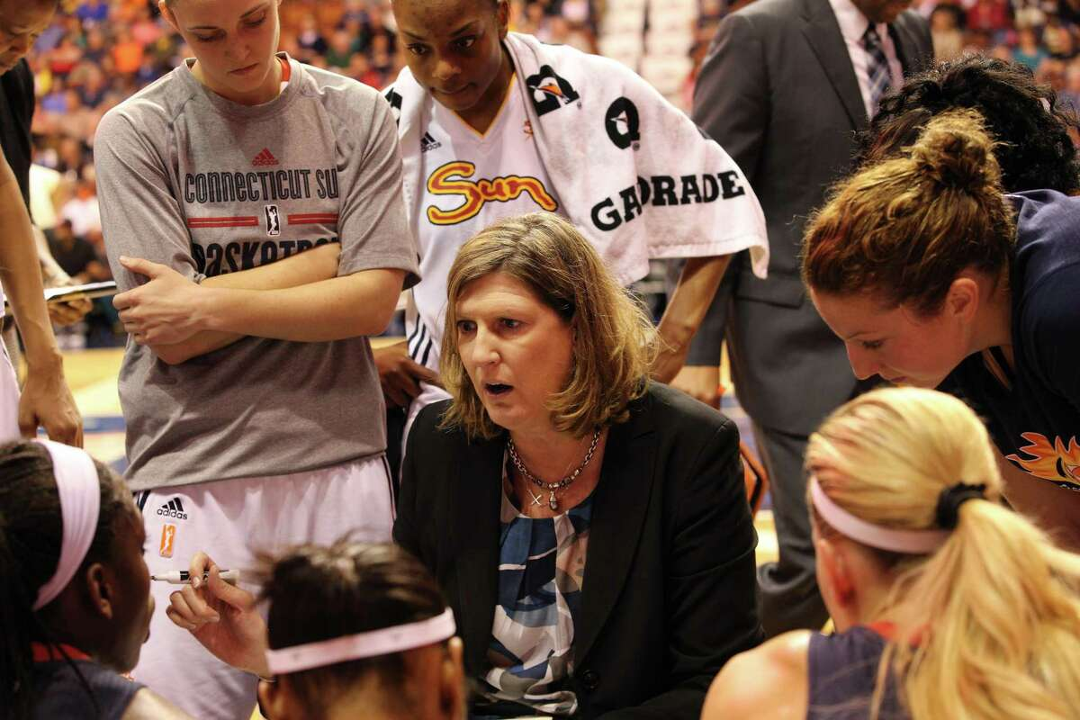 Anne Donovan, (centre), head coach of the Connecticut Sun, talks to her players during a time out during the Connecticut Sun Vs New York Liberty WNBA regular season game at Mohegan Sun Arena, Uncasville, Connecticut, USA. 16th May 2014. Photo Tim Clayton (Photo by Tim Clayton/Corbis via Getty Images)