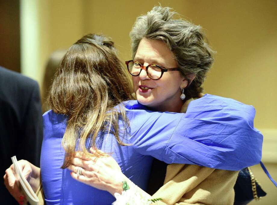 Pamela Kiernan of Darien hugs Madonna Badger, CCO and founder of Badger and Winters after chatting at the Girl Scouts of Connecticut 2018 Woman of Merit dinner at the Hyatt Regency Greenwich on June 13, 2018 in Greenwich, Connecticut. Photo: Matthew Brown / Hearst Connecticut Media / Stamford Advocate