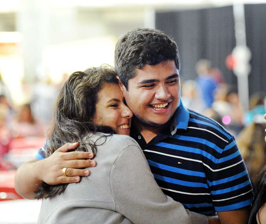 Ashley Balta, left, and Alvaro Jaramillo, both 17, embraced during their Greenwich High School AVID Graduation Ceremony in the student center at Greenwich High School, Conn., Wednesday, June 13, 2018. Balta said she will be attending the University of Connecticut and Jaramillo said he will attend the University of Scranton. The Advancement Via Individual Determination program (AVID), targets students in the academic middle and mentors them throughout their school years to prepare them for college. Forty-four Greenwich High School seniors graduated from the program. Photo: Bob Luckey Jr. / Hearst Connecticut Media / Greenwich Time