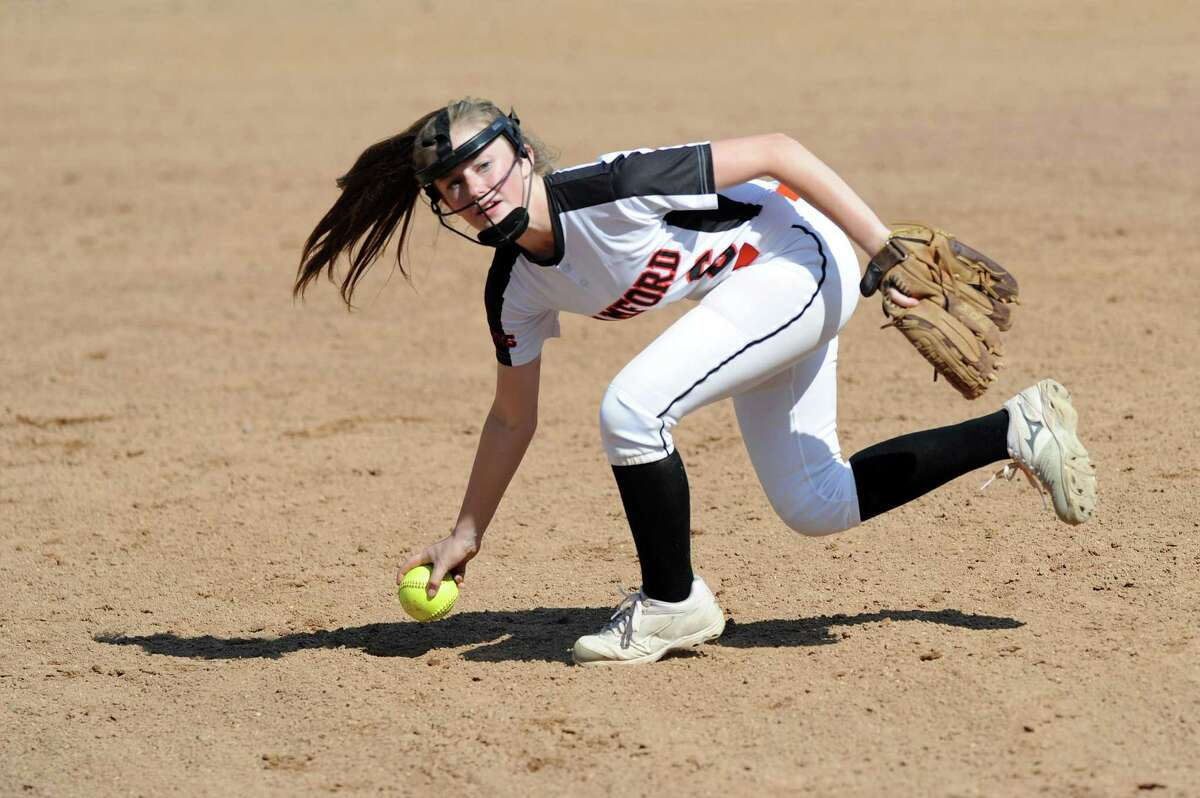 Stamford High School second baseman Gloria Mattioli scoops a ground ball with her bare hand before throwing to first during the FCIAC softball quarterfinal game against Norwalk High School at Stamford High in Stamford, Conn. on Wednesday, May 23, 2018. Stamford defeated Norwalk 16-3 in six innings.