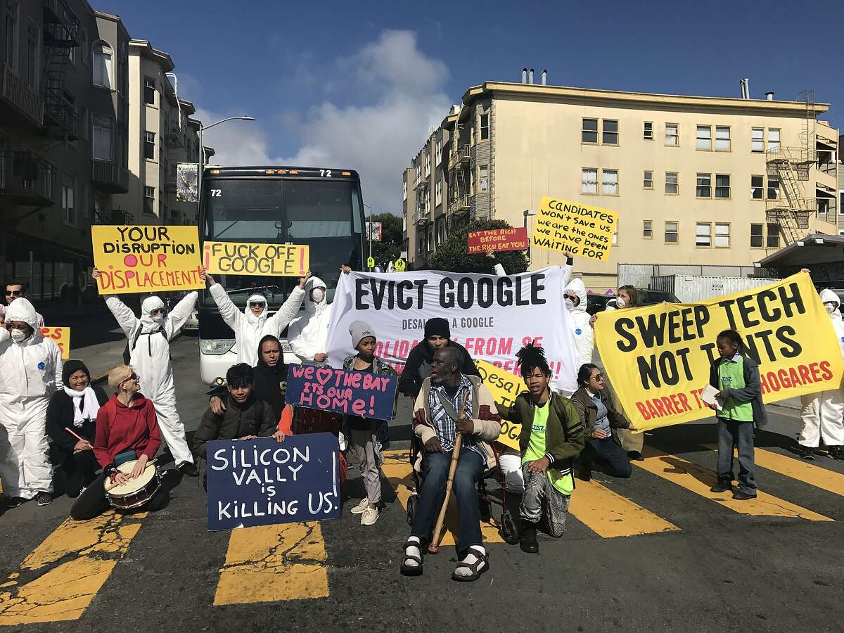 Anti-displacement posters block a Google shuttle bus on May 31, 2018 at the corner of 24th and Valencia in San Francisco, Calif.