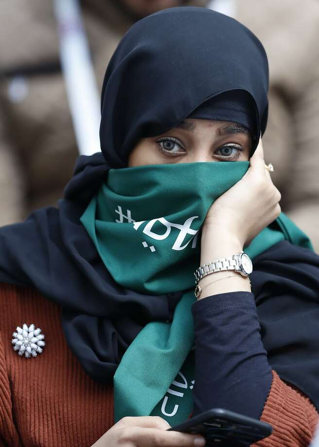 A Saudi woman attends the opening match at Luzhniki Stadium in Moscow. Photo: Hassan Ammar / Associated Press