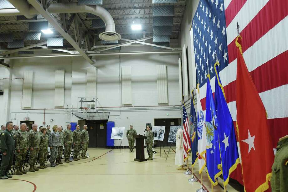 Sergeant First Class Brooke Albert, center, sings the National Anthem at an event at the New York State Division of Military and Naval Affairs Headquarters to celebrate the 243rd birthday of the United States Army on Thursday, June 14, 2018, in Latham, N.Y.   (Paul Buckowski/Times Union) Photo: Paul Buckowski / (Paul Buckowski/Times Union)