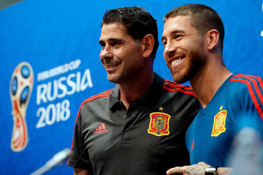 Spain coach Hierro Fernando and defender Sergio Ramos. Photo: Adrian Dennis / AFP / Getty Images