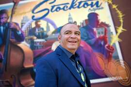 Sammy Nunez, director of the non-profit Father and Families of San Joaquin, poses for a portrait in front of a mural in Stockton, Calif., on Thursday June 14, 2018.