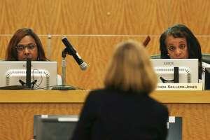 Houston ISD Interim Superintendent Grenita Lathan, left, and Board of Education President Rhonda Skillern-Jones listen to a speaker during a school board meeting on Thursday, June 14, 2018, in Houston.