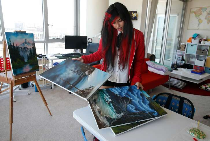 Shahmeen Kasim organizes watercolor paintings that she created for her Twitch followers at her home in San Francisco, Calif. on Wednesday, June 13, 2018. Kasim live streams herself painting watercolors and sculpting  in addition to playing games on Twitch.