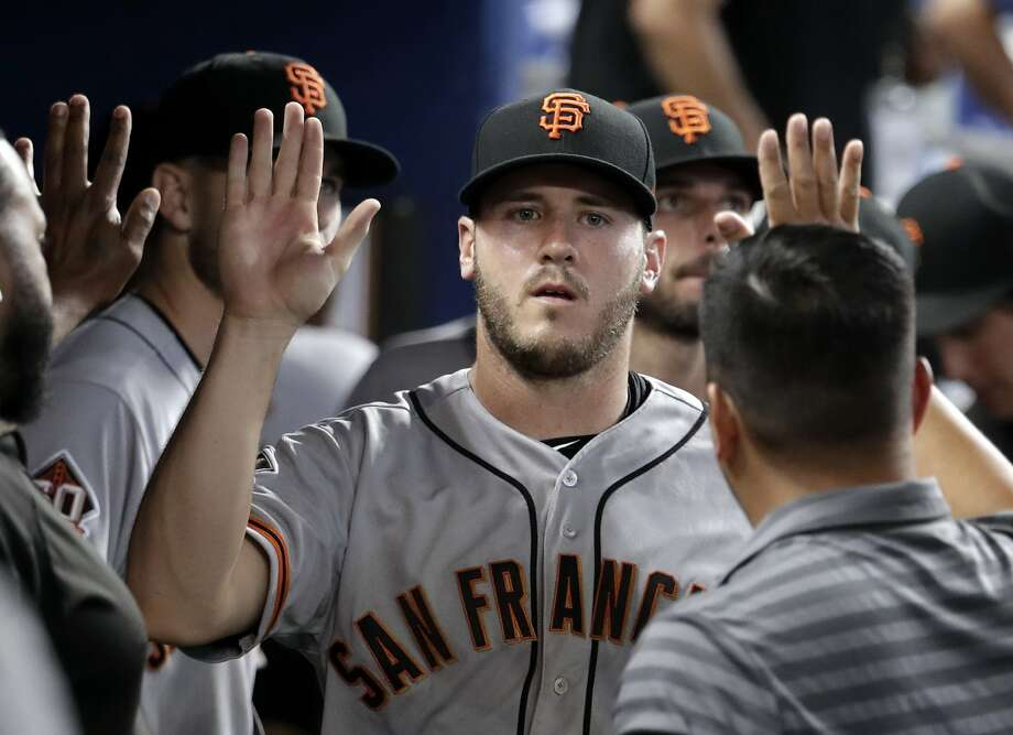 San Francisco Giants relief pitcher Ty Blach is congratulated in the dugout after being relieved in the 16th inning of a baseball game against the Miami Marlins, Thursday, June 14, 2018, in Miami. The Giants won 6-3 in 16 innings. (AP Photo/Lynne Sladky) Photo: Lynne Sladky / Associated Press