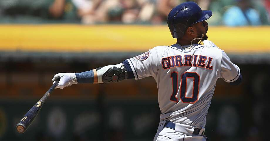 Houston Astros' Yuli Gurriel swings for an RBI double off Oakland Athletics' Frankie Montas in the first inning of a baseball game Thursday, June 14, 2018, in Oakland, Calif. (AP Photo/Ben Margot) Photo: Ben Margot/Associated Press