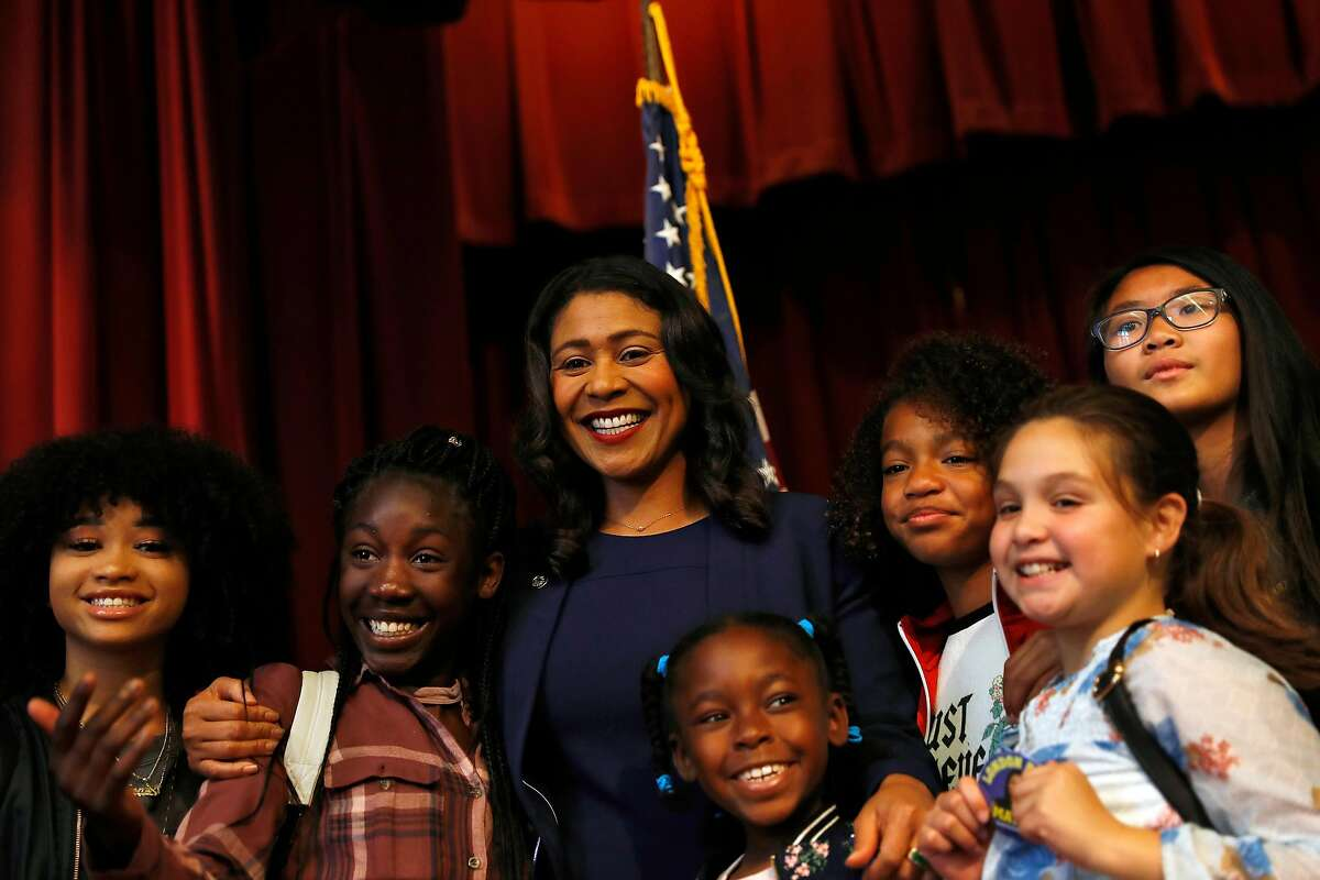 San Francisco Mayor-elect London Breed poses for a photo with a group of children after delivering her mayoral campaign victory speech at Rosa Parks Elementary in San Francisco.