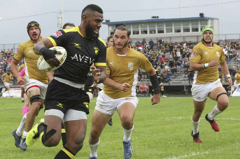 Houston SaberCats Alex Elkins (14) runs forward and scores a try while New Orleans Gold Holden Yungert (9) is tryign to stop him during the first half of the home opener of the Major League Rugby game at Dyer Stadium on Saturday, April 21, 2018, in downtown Houston. ( Yi-Chin Lee / Houston Chronicle ) Photo: Yi-Chin Lee / Houston Chronicle / © 2018 Houston Chronicle