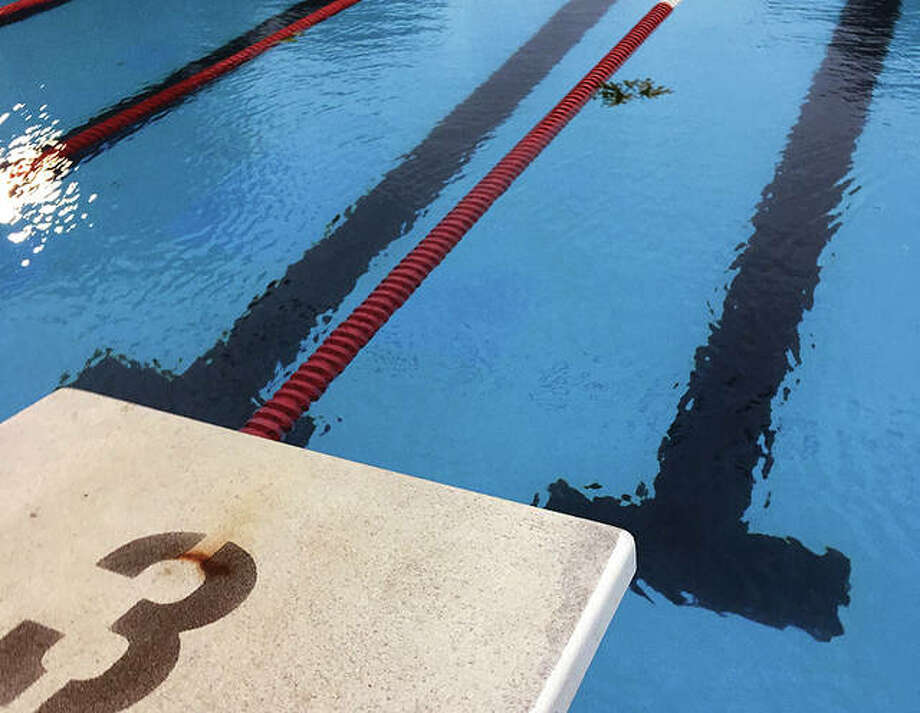 A few scattered leaves were the only things in the water Thursday night at the Summers Port pool after a thunderstorms forced officials to cancel the Summers Port Sharks' SWISA season opener with rival Water Works of Edwardsville. The meet has been rescheduled for July 10 at Summers Port. Photo:       Pete Hayes | The Telegraph